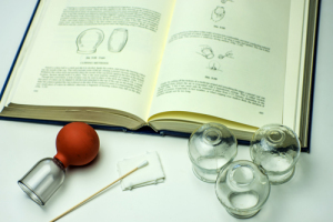 picture of glass cups and a book